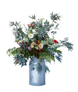 Large Floral Arrangement in an Old Milk Can Isolated with clipping path